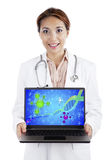 Scientist with dna reaction. Young female scientist showing sample of dna reaction on the laptop computer stock images