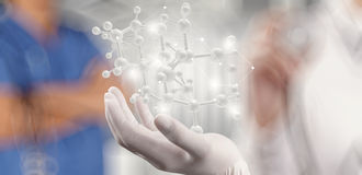 Scientist doctor hand holds virtual molecular stock image