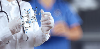 Scientist doctor hand holds virtual molecular Stock Photos