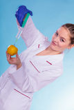 Scientist doctor injecting apple. GM Food. Royalty Free Stock Photos