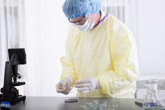 Scientist or doctor in protective gear working Stock Images