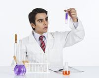 Scientist doing scientific experiment in a laboratory Stock Image