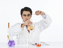 Scientist doing scientific experiment in a laboratory Stock Photography