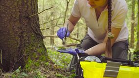 Scientist ecologist in the forest taking samples of plants. Close up woman`s hands in protective gloves. Scientist ecologist in the forest opening toolbox, then stock video