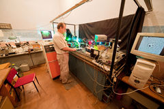 Scientist engaged in research in his lab. About movement of microparticles by laser Stock Images