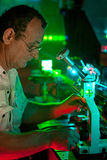 Scientist engaged in research in his lab. Show movement of microparticles by laser Royalty Free Stock Image