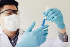 Scientist with equipment and science experiments in laboratory. royalty free stock image