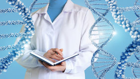 A scientist examines DNA. royalty free stock image