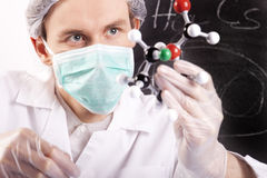 Scientist Examing Atoms Stock Photos