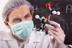 Scientist Examing Atoms Stock Images