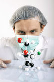 Scientist Examing Atoms Royalty Free Stock Images