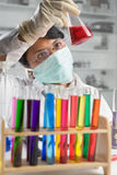 Scientist examining chemical solution Stock Image