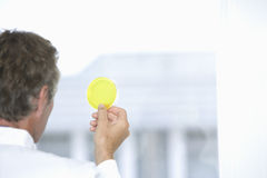 Scientist Examining Yellow Petri Dish Stock Images