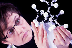 Scientist Exams Molecules Royalty Free Stock Images