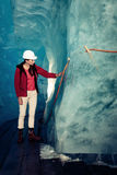 Scientist At An Expedition Site Examining A Glacier Royalty Free Stock Photo
