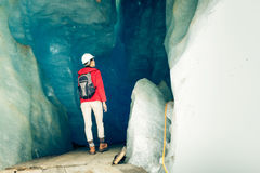 Scientist At An Expedition Site Examining A Glacier Royalty Free Stock Image