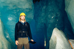Scientist At An Expedition Site Examining A Glacier.  royalty free stock photos
