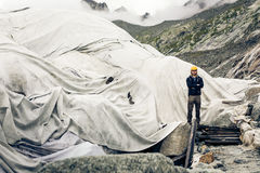 Scientist At An Expedition Site Examining A Glacier.  royalty free stock image