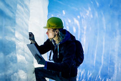 Scientist At An Expedition Site Examining A Glacier Stock Photos