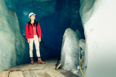Scientist At An Expedition Site Examining A Glacier.  royalty free stock images
