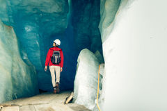 Scientist At An Expedition Site Examining A Glacier.  stock images