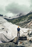 Scientist At An Expedition Site Examining A Glacier.  stock photography