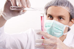 Scientist Experimenting. Witch red fluids in laboratory Stock Images