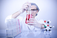 Scientist Experimenting with Fluid Stock Photo