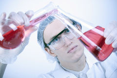 Scientist Experimenting with Fluids Stock Photography