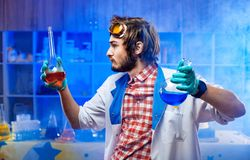 Scientist with flasks in lab royalty free stock photography