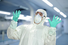 Scientist in full protective hazmat suit Royalty Free Stock Image