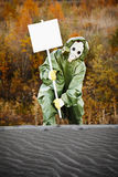 Scientist in gas mask with poster Royalty Free Stock Image