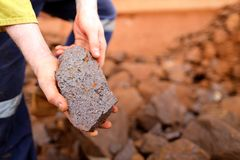 Free Scientist Geologist Hands Inspecting Exploration On Iron Ore Rock On Open Field Mine Site Royalty Free Stock Photo - 159004655