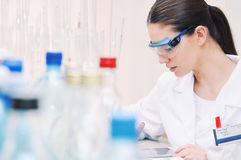 Scientist in glasses working at the laboratory Stock Photo