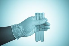 Scientist hand holding test tubes Stock Photo