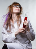 Scientist happy woman with results. Of searching on gray background Royalty Free Stock Photos