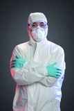Scientist with Hazmat suit. Isolated on a dark background Royalty Free Stock Images