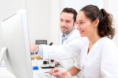 Scientist and her assistant in a laboratory Royalty Free Stock Images