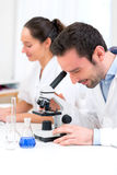 Scientist and her assistant in a laboratory Royalty Free Stock Photography
