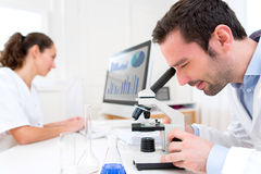 Scientist and her assistant in a laboratory Royalty Free Stock Photo