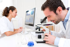 Scientist and her assistant in a laboratory Stock Image