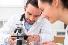 Scientist and her assistant in a laboratory Royalty Free Stock Image