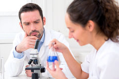 Scientist and her assistant in a laboratory Royalty Free Stock Photos