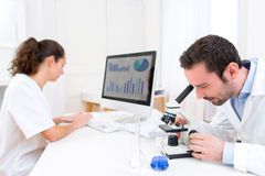 Scientist and her assistant in a laboratory Stock Images