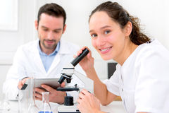 Scientist and his assistant in a laboratory Stock Image