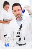 Scientist and his assistant working in a lab Royalty Free Stock Photography