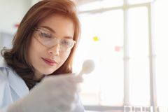 Scientist hold cotton to collect new sample stock image
