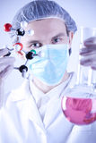 Scientist holding Atoms Stock Images