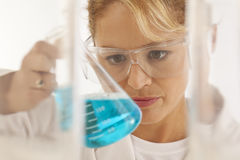 Scientist holding beaker Royalty Free Stock Image