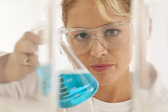 Scientist holding beaker Royalty Free Stock Images